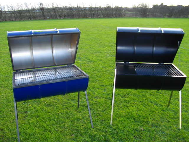 new barrel barbecues one black deluxe barrel barbecue and one blue original barrel barbecue